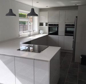 hanging lights being installed by niceic electrician in southend kitchen area